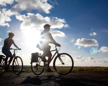 Two silhouettes of Cyclists